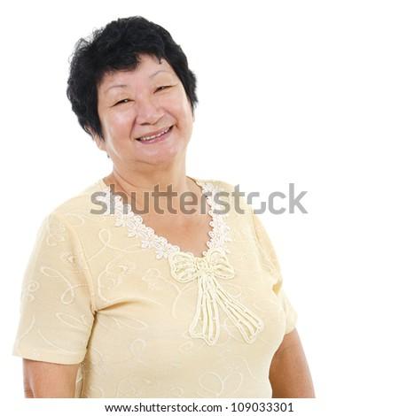 60s Asian senior woman smiling over white background - stock photo