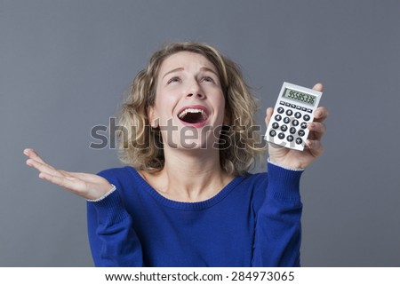 20s blonde girl thrilled at her financial situation - stock photo