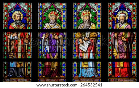 'S HERTOGENBOSCH, THE NETHERLANDS - JULY 23, 2011: Stained Glass in Den Bosch. The saints depicted are Saint Ephrem, Saint Gregory of Nyssa, Cyrpian of Carthage and Saint Cyril of Alexandria