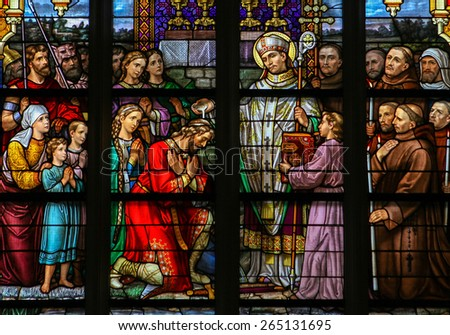 'S HERTOGENBOSCH, THE NETHERLANDS - JULY 23, 2011: Stained Glass Window depicting Saint Wilibrord baptising the Frank Aengilbert in Den Bosch Cathedral, North Brabant.