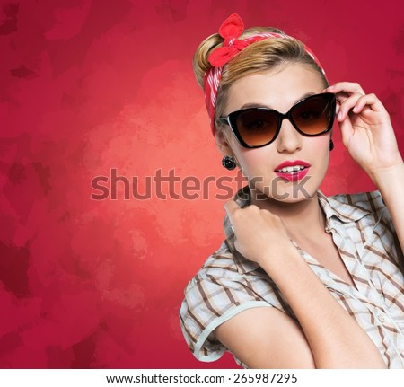 50s. Pinup girl with magnifying glass, portrait of young happy sexy woman in pin-up style, over white - stock photo