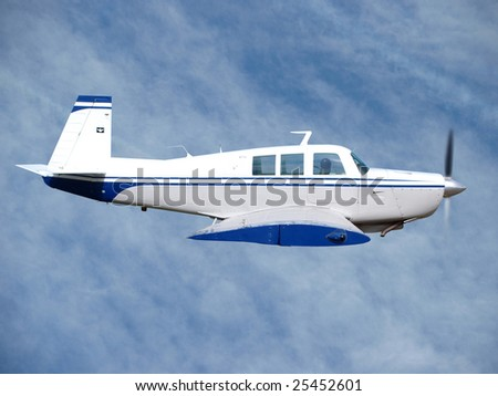 1980s private aircraft in flight against light cloud - stock photo