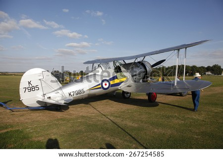 1930's RAF Gloster Gladiator fighter aircraft at a Shuttleworth Collection air display at Old Warden airfield, Bedfordshire ,UK. taken 26/09/2012 - stock photo