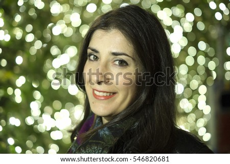 30s real woman with bokeh ligths background