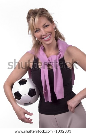 30s 40s woman smiling with soccer ball - stock photo