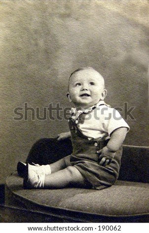 1940's smiling baby boy.  Black and white vintage. - stock photo