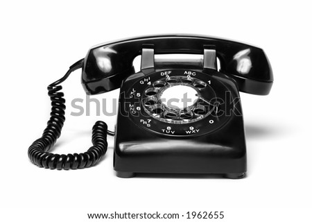 1960s style antique black telephone isolated on white