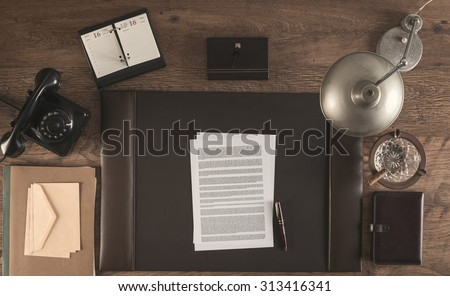 1950s style office with a contract and a pen, top view - stock photo