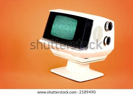 70's tv set on orange background - stock photo