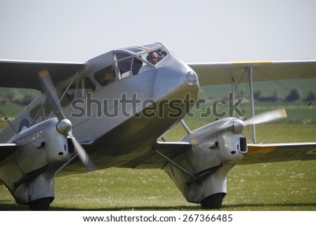 1930s vintage Dragon Rapide transport aircraft at the Flying Legends Air Display held at Duxford airfield,Cambridgeshire,UK.taken 14/07/2013 - stock photo
