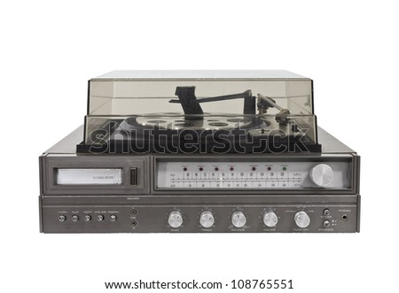 1970's vintage stereo with eight track, radio and turntable. - stock photo
