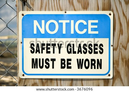 'Safety Glasses Must Be Worn' Notice sign.