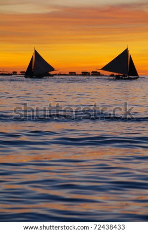 sailboat in sunset - stock photo