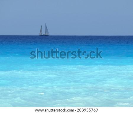 sailboat with a white sail, blue Mediterranean sea ocean horizon - stock photo