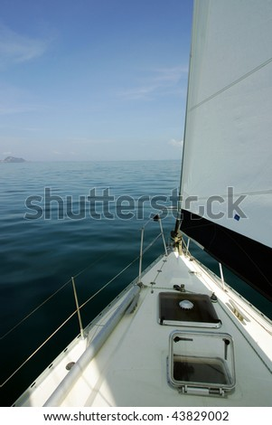 Sailboat with open sail on sunny day, Thailand