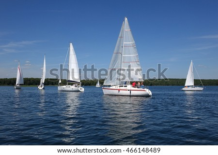 Sailboats floating in the water of the lake.Russia.Competition sport of sailing. Yacht and beautiful seascape.Reserve Lake of Russia.