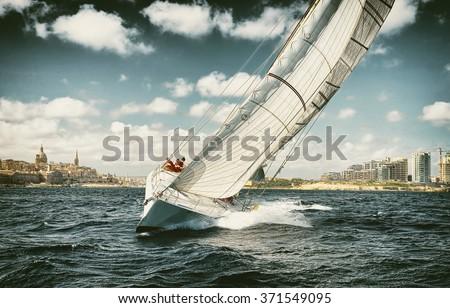 . Sailing yachts regatta.  Yachting. Sailing. Toned image and blur. Retro style postcard.  - stock photo