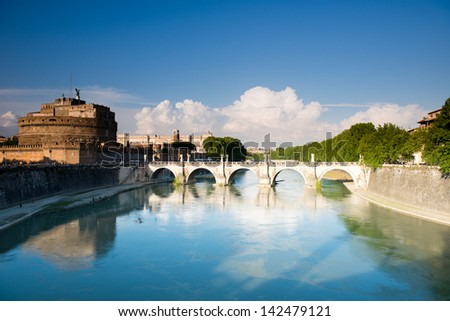 Saint Angel castle and bridge over the Tiber river in Rome, Italy. - stock photo