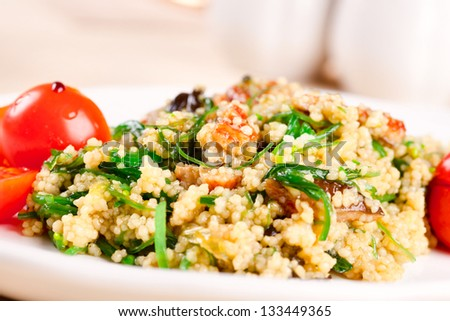 Salad with seaweed, eel, couscous and cherry