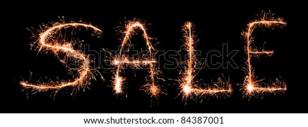 """""""Sale"""" made of sparklers - stock photo"""