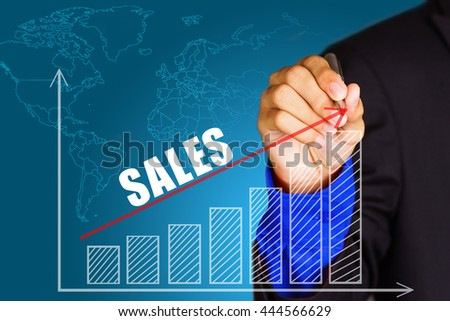 """""""Sales"""" text with hand of young businessman point on virtual graph red line and bar showing on increasing with background -business, finance, salary, crisis, and development concept - stock photo"""
