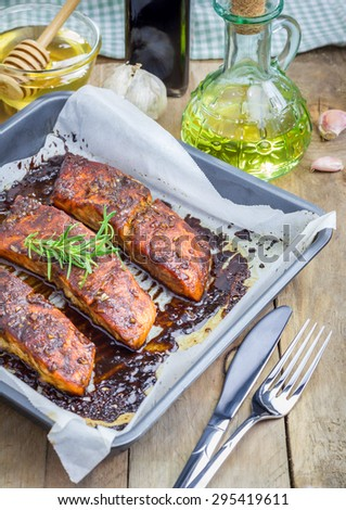 Salmon fillet with balsamic-honey sauce in baking dish, baked - stock photo