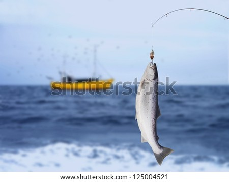 salmon on fishing-rod on background of sea - stock photo