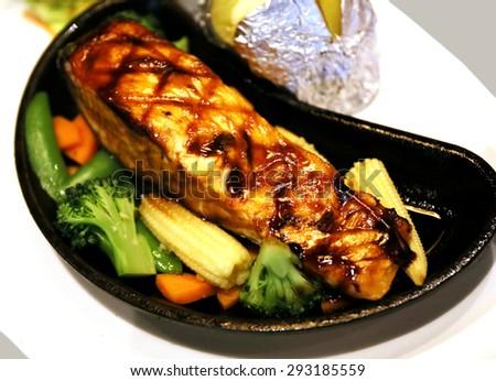 salmon steak with Teriyaki sauce - stock photo