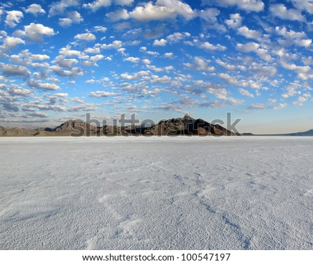Salt Flats in foreground,mountains background, and a blue sky with hundreds of small puffy clouds./  Bonneville Salt Flats #4 / Natures beauty and a hot rodders dream.