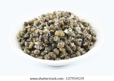 Salted capers with large crystals of sea salt - stock photo