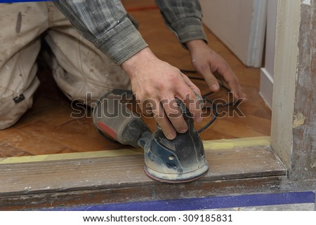 sanding wooden door   - stock photo
