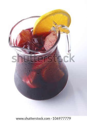 �Sangria� is a typical Spanish and Portuguese wine punch. Ingredients: red wine, chopped fruit, sweetener, a soft drink, and sometimes a small amount of brandy or any other liquor. - stock photo