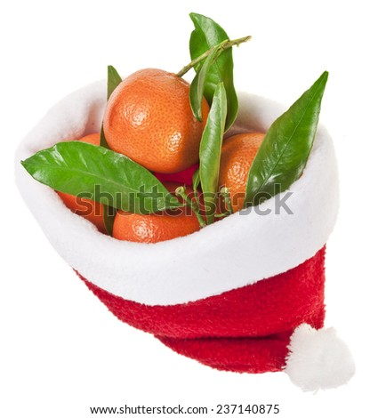 Santa Claus hat`s full  tangerines fruits  isolated on a white background - stock photo