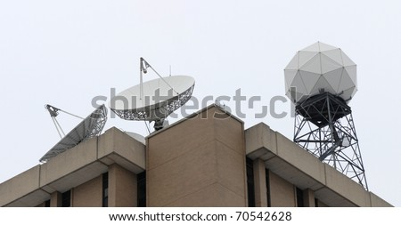 satellite dish and radar dome - stock photo