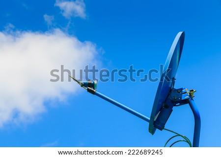 satellite dish on sky background - stock photo
