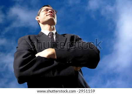 Satisfied  professional with eyeglasses on sky background. - stock photo