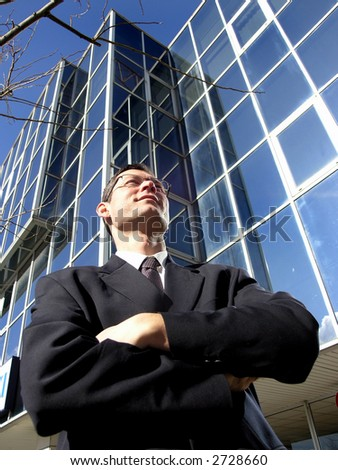 Satisfied  young professional with eyeglasses. - stock photo