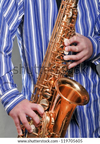 Saxophonists Hands - stock photo