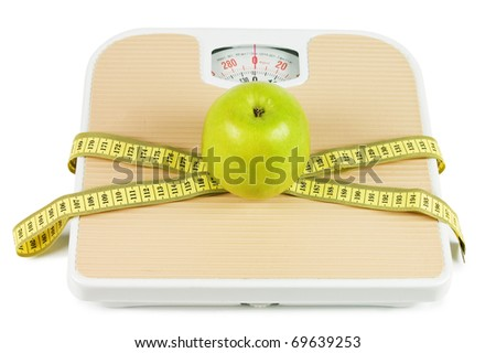 Scale, tape and apple on white background - stock photo