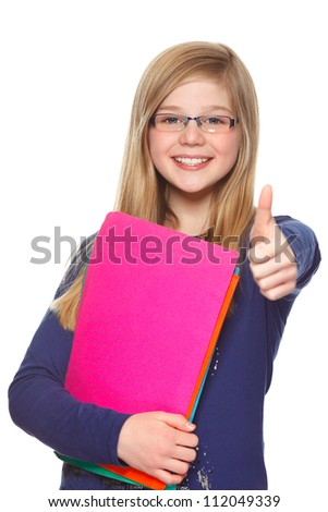 schoolgirl  holding thumb up and smiling - stock photo