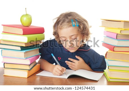 schoolgirl works on her homework, write something in her notepad, isolated on white