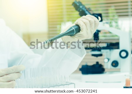 (SCIENCE) Scientists are certain activities on experimental science like mixing chemicals, microscope, entry data to develop science medicine or food for everyone on the world, Film effect. - stock photo