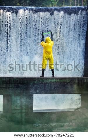 scientist examining toxic substance in contaminated area - stock photo