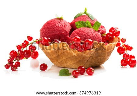 Scoops ice cream made of redcurrant  in a wafer bowl and berries isolated on white background - stock photo
