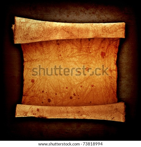 scroll of old parchment, on a vintage background - stock photo