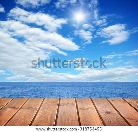 sea and wooden platform - stock photo