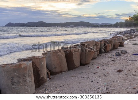 sea wave hit the concrete barrier save the shore - stock photo