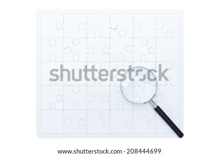 searching success by magnifying glass on white blank jigsaw business concept isolate on white background with clipping path - stock photo