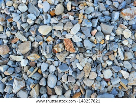 seashore stones rocks eroded ocean washed pebbles , big sur, california, usa. beach weathered sea background - stock photo