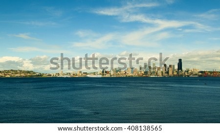 SEATTLE, WA, USA - MAY 21: A view of Seattle downtown, skyscraper, business district and blue ocean from Alki Beach, Seattle, Washington, United States, on 21 May 2010